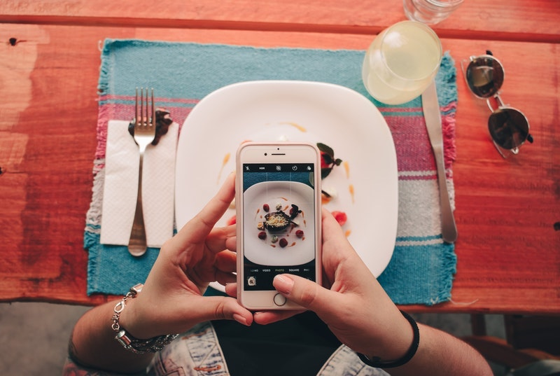 satisfied customer takes pictures of food