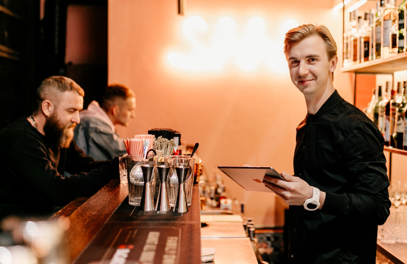 A bartender in a trendy bar